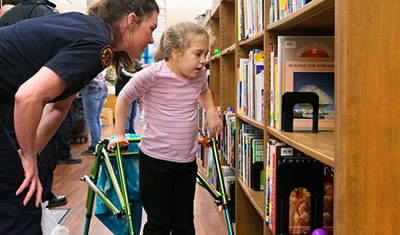 Fire Fighter help disabled student in library